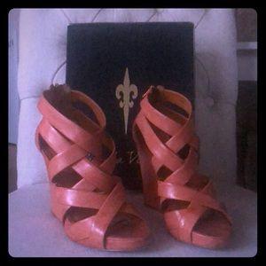 Pour La Victoire Orange Wedge Heel Sandal.
